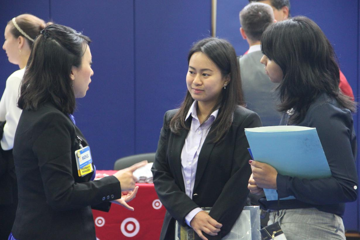 an employer talks to student pharmacists at a career fair