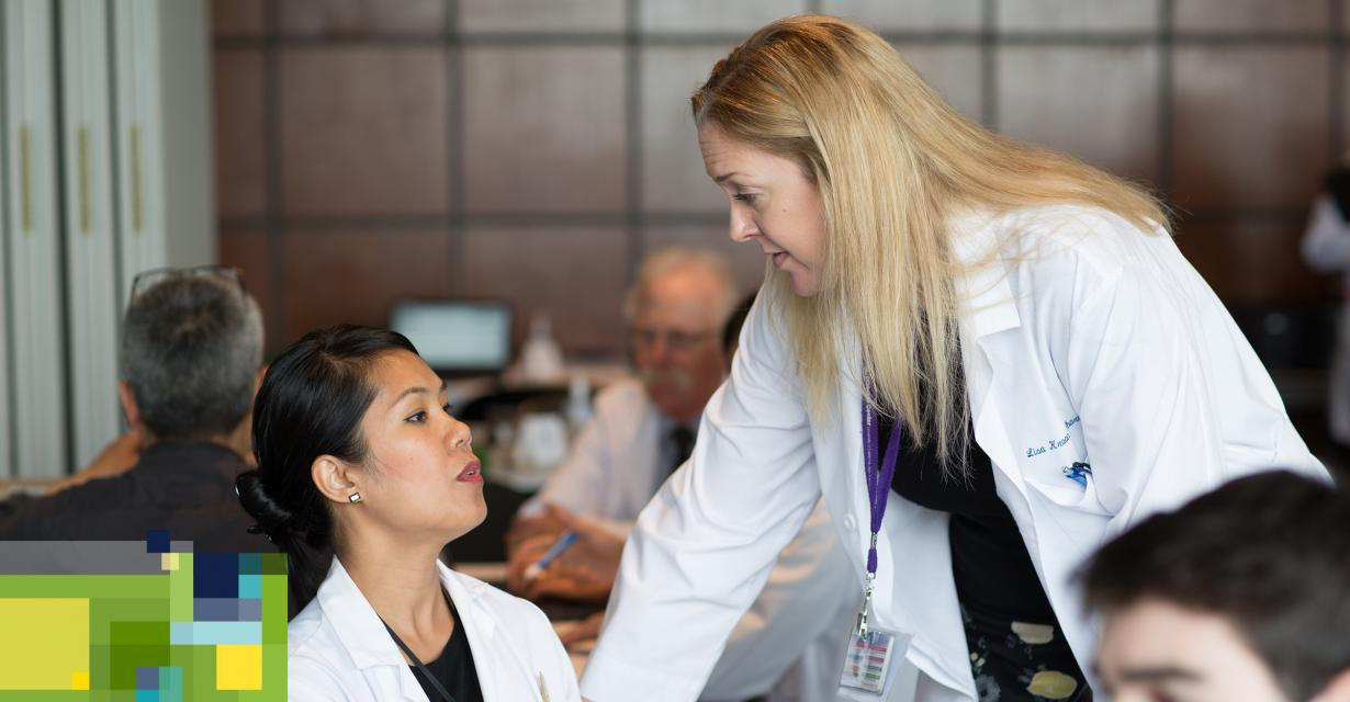 faculty members discuss a patient's medications