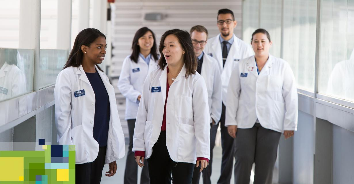 student pharmacists wearing white coats