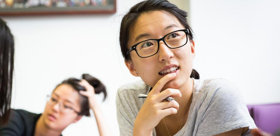 Student listening thoughtfully in seminar room